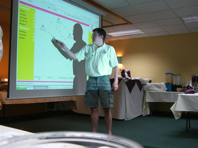 Justin Krohn, WTI student research assistant, shows an OLSR visualization of a live mesh network.